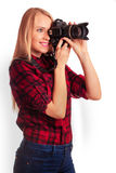 Glamour amateur photographer holding a professional camera  Stock Images