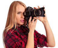 Glamour amateur photographer holding a professional camera - iso Royalty Free Stock Photography