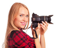 Glamour amateur photographer holding a professional camera - iso Stock Images