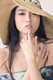 Glamour of Asian beauty. With hat, closeup portrait Stock Photography
