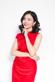 Glamour asian woman in stylish red party dress.  Stock Images