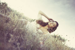 Glamour attractive girl in grass Royalty Free Stock Photo
