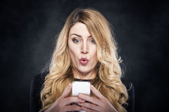 Glamour attractive woman holding her mobile phone. Royalty Free Stock Photo