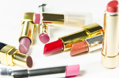 Glamour beautiful different lipsticks isolated on white background. Colorful. Stock Images