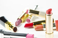 Glamour beautiful different lipsticks isolated on white background. Colorful. Stock Image