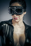 Glamour, Beautiful woman dressed in black latex with glasses air Stock Photos