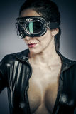 Glamour, Beautiful woman dressed in black latex with glasses air Stock Photography