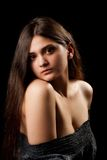 Glamour beauty. Glamour image of a beautiful brunette isolated on black background Stock Images