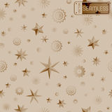 Glamour beige seamless texture background with stars and snowflakes Royalty Free Stock Images