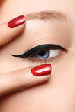 Glamour black arrow makeup close with fashion red Stock Image