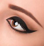 Glamour black eye make up with wide arrow Royalty Free Stock Images