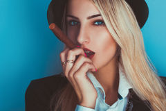 Glamour blonde sexy woman smoking a cigar Stock Photos
