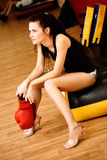 Glamour boxer. Woman will boxing in unsuitable shoes Stock Images