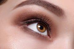 Glamour brown eye make up close Stock Photos