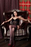 Glamour brunette wearing black lingerie Royalty Free Stock Photos