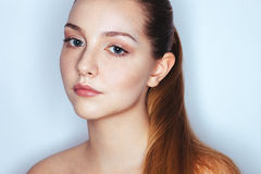 Glamour close up portrait of young beautiful woman model with trendy makeup. Fashion shiny highlighter on skin, gloss lips ma Stock Photo