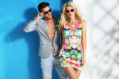 Glamour couple wearing trendy summer stuff Stock Images