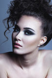 Glamour Curly Hairstyle Beautiful Young Woman. Perfect skin Royalty Free Stock Photography