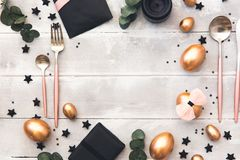 Glamour easter place table setting with copy space. Top view stock photo