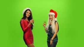 Glamour. Elated Woman Celebrating New Year, green. Glamour. Elated Woman Celebrating New Year, Christmas or Birthday. green screen, two girls stock video