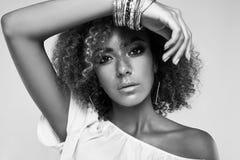 Glamour elegant black hippy woman model with curly hair. Sensual portrait of glamor elegant black hippy woman model with curly hair posing on colorful background royalty free stock photos