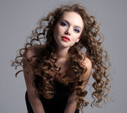 Glamour face of teen girl with long curly hair Royalty Free Stock Photography