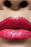 Glamour fashion bright pink lips glossy make-up. Macro shoot Royalty Free Stock Photos
