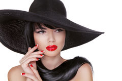 Glamour Fashion Brunette Woman Portrait in black hat isolated on Royalty Free Stock Photo