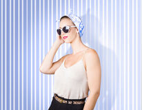 Glamour fashion girl on retro striped background Stock Images
