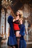 Glamour fashion model girl  in elegant fur coat and lingerie. Stock Images