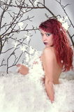 Glamour fashion model lady in feathers Stock Image