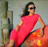 Glamour fashion model posing on the beach Royalty Free Stock Photography