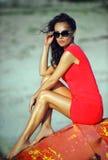 Glamour fashion model posing on the beach Stock Photos
