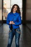 Glamour Fashion Model Wearing Blue Leather Jacket Stock Photography