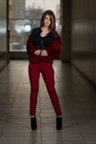 Glamour Fashion Model Wearing Red Pants And Jacket Royalty Free Stock Photos