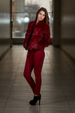Glamour Fashion Model Wearing Red Pants And Jacket Stock Photo