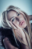 Glamour fashion portrait of beautiful blonde young woman in fur Royalty Free Stock Images