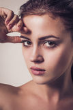 Glamour fashion portrait of young attractive woman with sexual stare Royalty Free Stock Photos