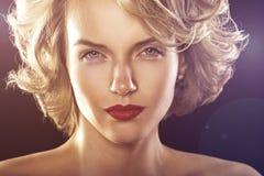 Glamour fashion shine portrait of beautiful curly woman royalty free stock image