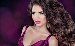 Glamour Fashion Woman Portrait. Beautiful brunette with long wav Stock Photo
