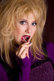 Glamour female with lollipop close-up Stock Photos
