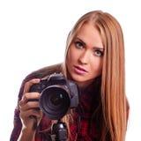 Glamour female photographer taking images - isolated on white stock image