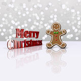Glamour Gingerbread Christmas Man. Delicious Christmas illustration: Decorated gingerbread man and red metallic 3D greeting on a light glamourous bokeh Royalty Free Stock Image