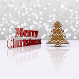 Glamour Gingerbread Christmas Tree. Delicious Christmas illustration: Decorated gingerbread tree and red metallic 3D greeting on a light glamourous bokeh Stock Photos