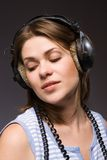 Glamour girl. With black  headphones Royalty Free Stock Photography