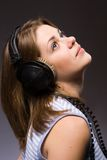 Glamour girl. With black  headphones Royalty Free Stock Photo