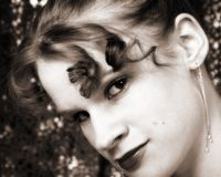 Glamour Girl. Beautiful young girl with a shimmery backdrop.  Sepia toned Stock Photos
