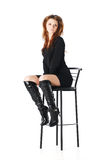 Glamour girl on a bar chair. Isolated on white Stock Photo