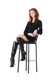 Glamour girl on a bar chair. Isolated Stock Photography