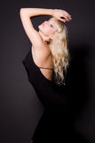 Glamour girl in black dress. Studio shot royalty free stock image